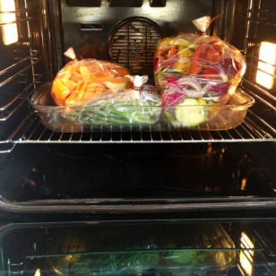 My Mediterranean vegetables, butternut squash and asparagus tips being cooked inside roasting bags in the oven
