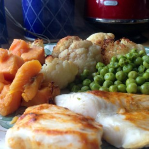 Tonight's dinner is Basa fillet with sweet potatoes, peas and cauliflower