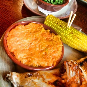Lunch time at Nando's ^___^ Sweet potato mash, Peas parsley mint and chilli, Corn on the cob and chicken breast.