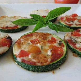 Thick sliced courgette baked with tomato and basil
